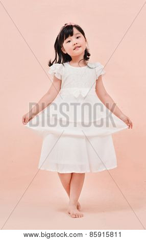 Full body Portrait of cute child posing pink background