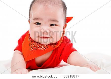 smiling baby from top on bed