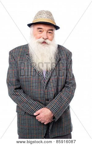 Senior Male Posing With Hat