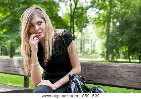 Flirt - Young Woman Siting On Bench