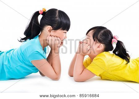 happy two asian little girls on the white background