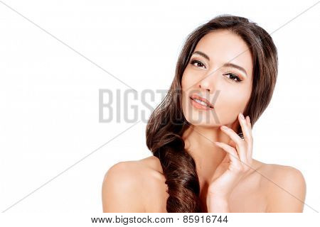 Beautiful sensual woman touching her face. Beauty and skincare concept. Spa. Isolated over white.