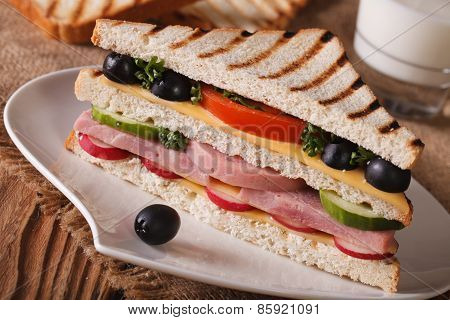 Sandwich With Ham On A Plate And Milk. Horizontal Closeup