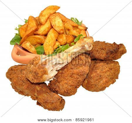 Fried Chicken Portions And Potato Wedges