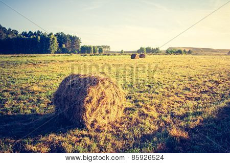 Vintage Photo Of Meadow With Hay Bales At Sunrise