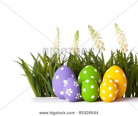 Easter eggs lying on the meadow