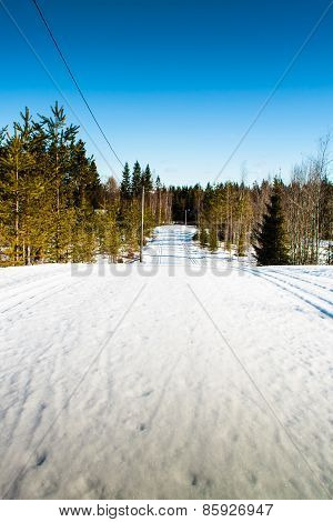 Ski Tracks Leading To The Horizon