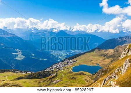 Bettmersee (lake) And The Alps In Valais