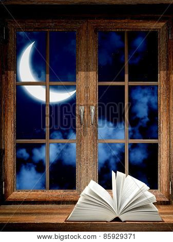 Open book on wooden windowsill