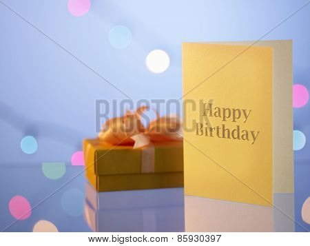 birthday card with a gift by the side