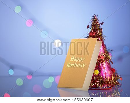 party hat and birthday card with  glitter background