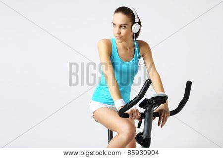 A woman riding a bike training