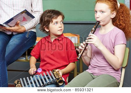 Children having music lessons in elementary school class
