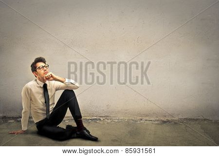 Businessman sitting on the ground