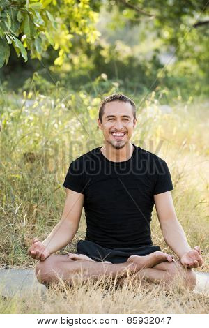 Young man practicing yoga and meditating