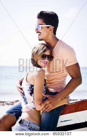Young couple at the beach with a fashion style