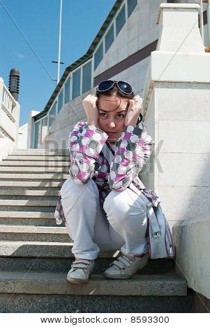 Sad Girl On Stairway