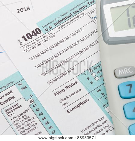 Us 1040 Tax Form And Calculator Over It