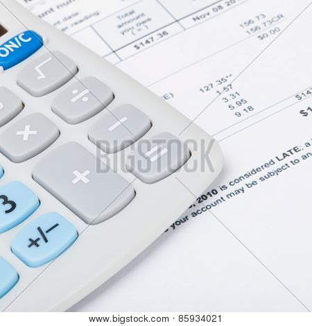 Calculator With Utility Bill Under It - Studio Shot