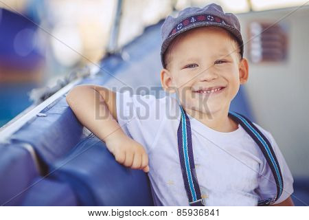 Little boy holds a vacation at my father's boat.