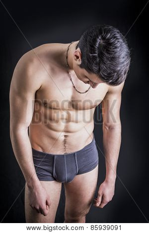 Handsome, Fit Shirtless Young Man Wearing Only Underwear