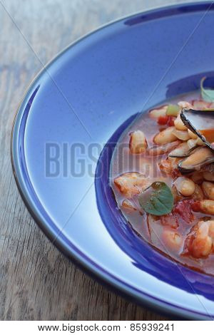 Beans and seafood soup.