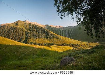 Caucasian Mountains At The Sunset