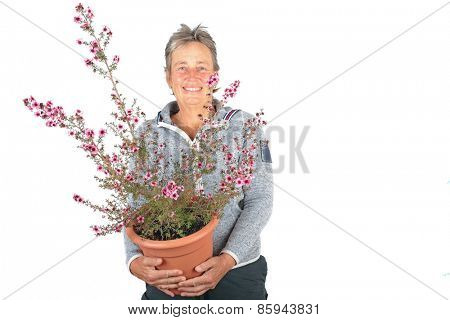 Beautiful mature woman with a beautiful blossoming plant