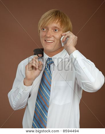 Young Man Talks By Mobile Phone