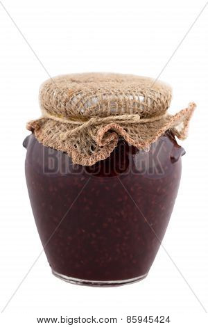 Raspberry Jam In A Glass Jar On A White Background