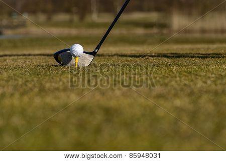 Golfer Teeing-off On The Fairway