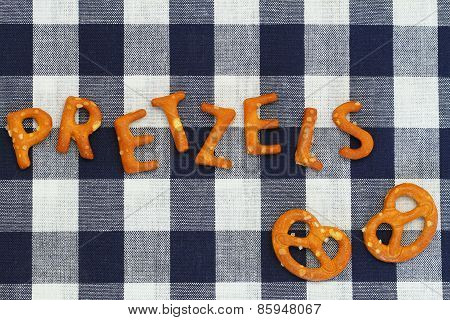 Word pretzels written with pretzel-like letters on checkered cloth