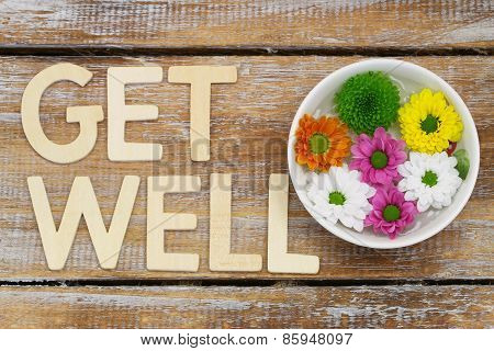 Get well written with wooden letters and Santini flowers on rustic wood