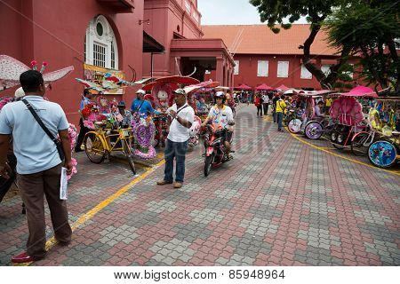 MALACCA, MALAYSIA - CIRCA JANUARY, 2015: Parking rickshaws in Dutch Square in Malacca. Malacca was included in the list of UNESCO World Heritage Sites in 2008.