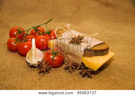 Sandwich With Cheese, Cherry Tomatoes And Garlic On Old Cloth
