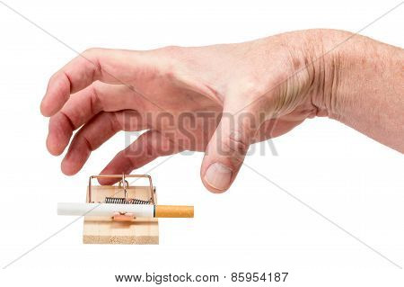 Hand Reaching For Cigarette In Mousetrap