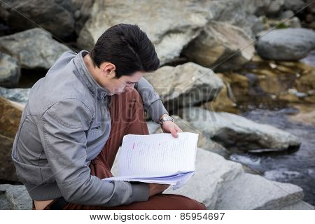 Young Male Student Studying Outdoors