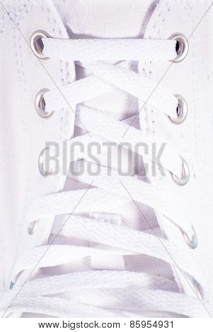 White lace on white sneakers close up