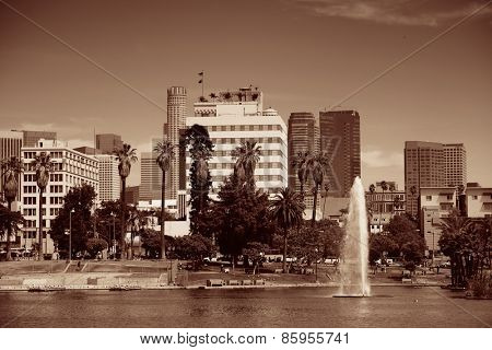 Los Angeles downtown view from park with urban architectures and fountain.