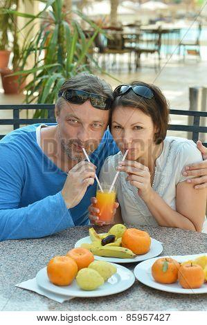 Happy couple at breakfast