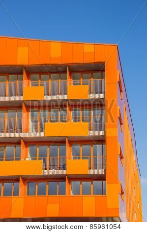 Balconies At A Modern Orange Appartment Building In Groningen