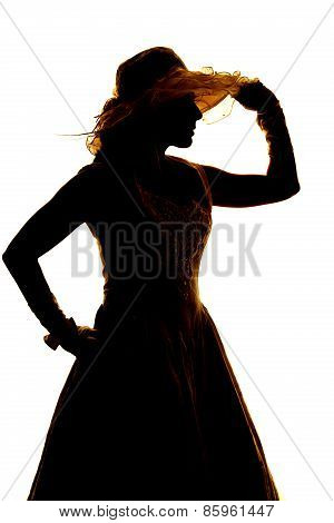 Silhouette Of A Woman In A Dress Gloves And Hand On Hat