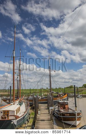 Old Wooden Ships In The Harbor Of Ditzum