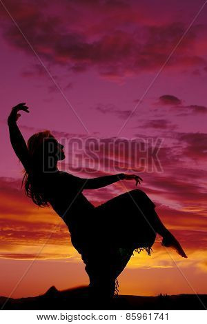 Silhouette Of A Woman In A Skirt Kneel Leg Up