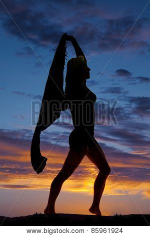 Silhouette Of A Woman With A Sarong Blowing Step Forward