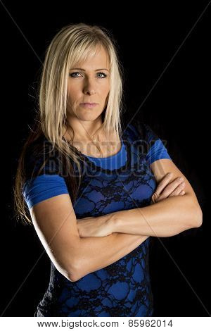 Woman Blue And Black Shirt Arms Folded Serious