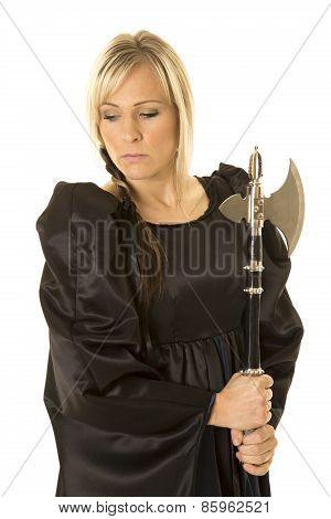 Woman In Black Cloak Holding Hatchet Looking Down