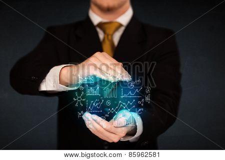 Businessman holding hand drawn business schemes
