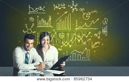 Successful business couple with all kind of hand-drawn business diagrams in background