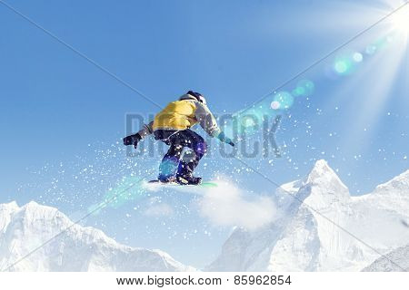 Man on snowboard jumping in sky. Summer vacation